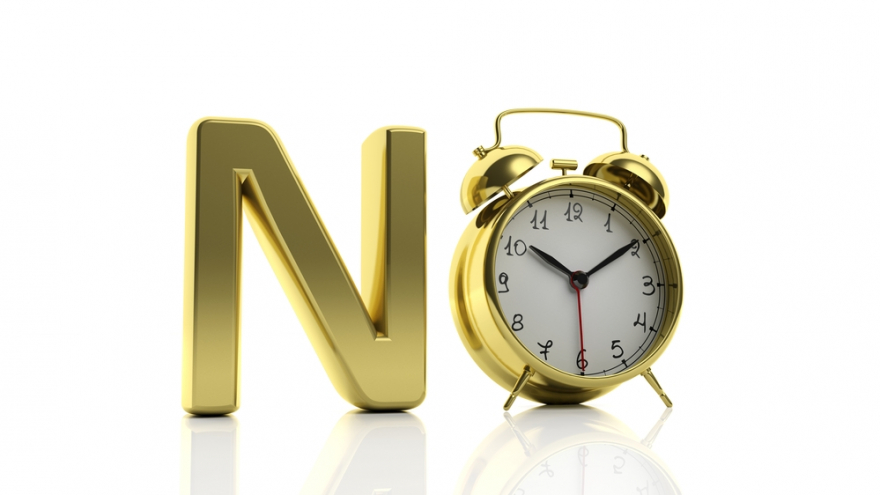 3D golden word No with alarm clock as