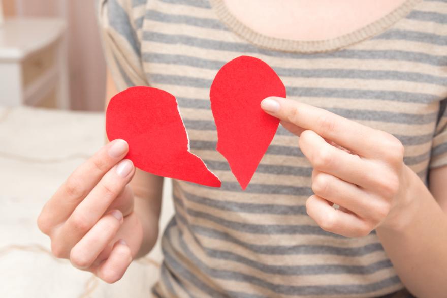 broken heart held in hands