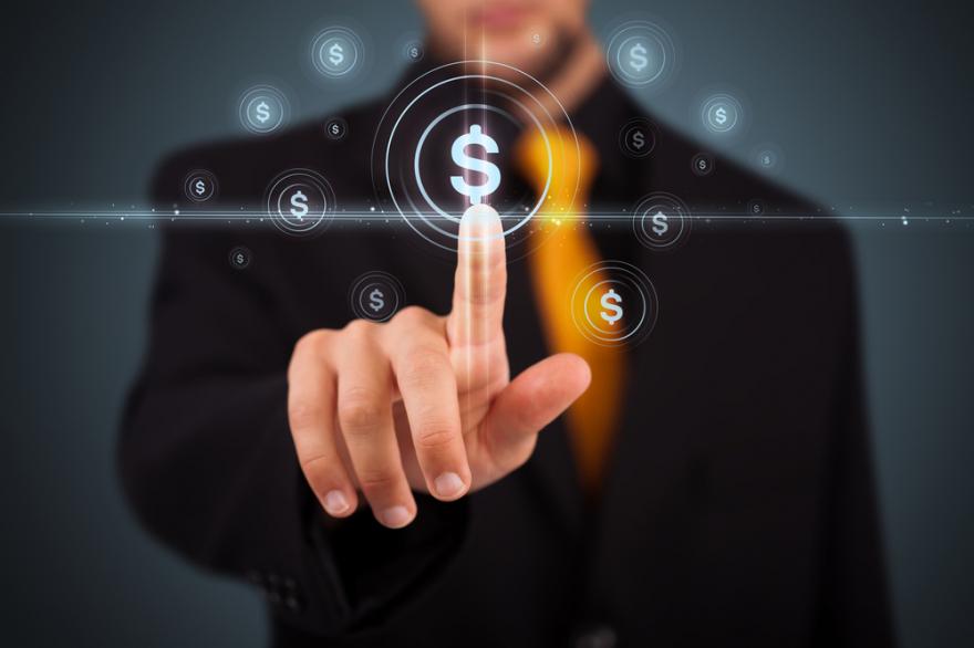 Businessman pressing money button