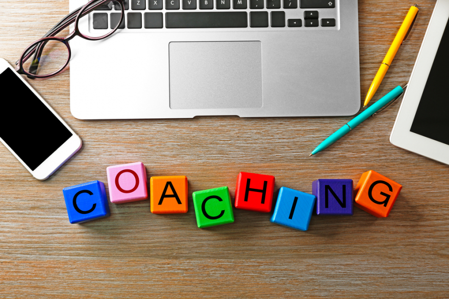 coaching concept. wooden cubes