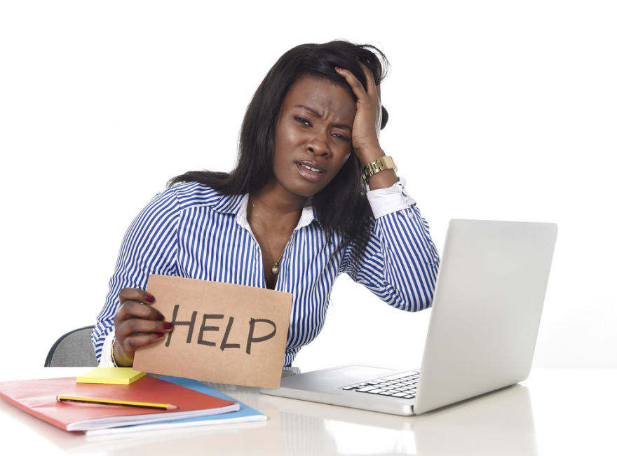 distressed woman holding a help sign