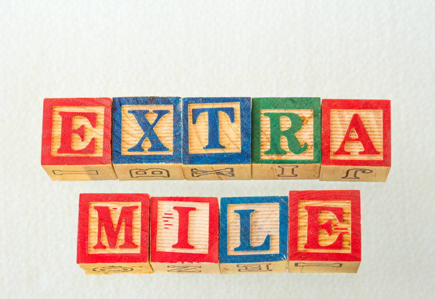 the words extra mile visually displayed