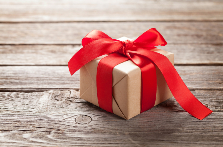 Valentines day gift box on wooden background