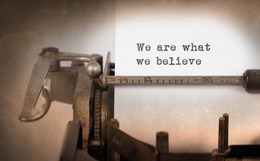 we are what we believe written on an old typewriter
