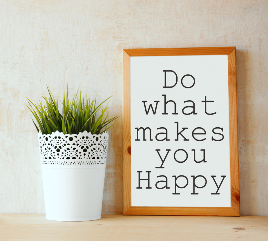 white drawing board with do what makes you happy written on it
